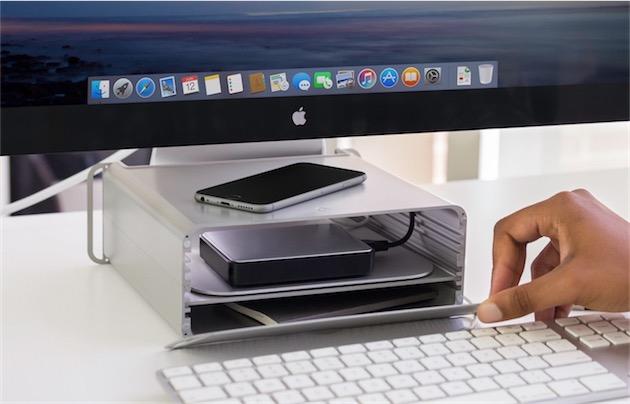 Il sagit dun support en métal pour iMac qui dune part surélève lordinateur (la hauteur est ajustable), et dautre part peut servir de rangement.