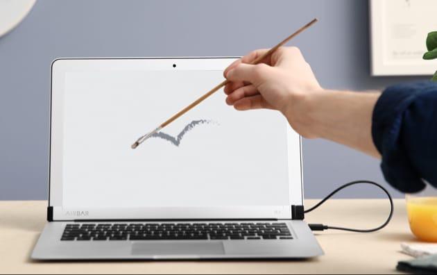 airbar ajoute un cran tactile au macbook air 13 39 39 macgeneration. Black Bedroom Furniture Sets. Home Design Ideas