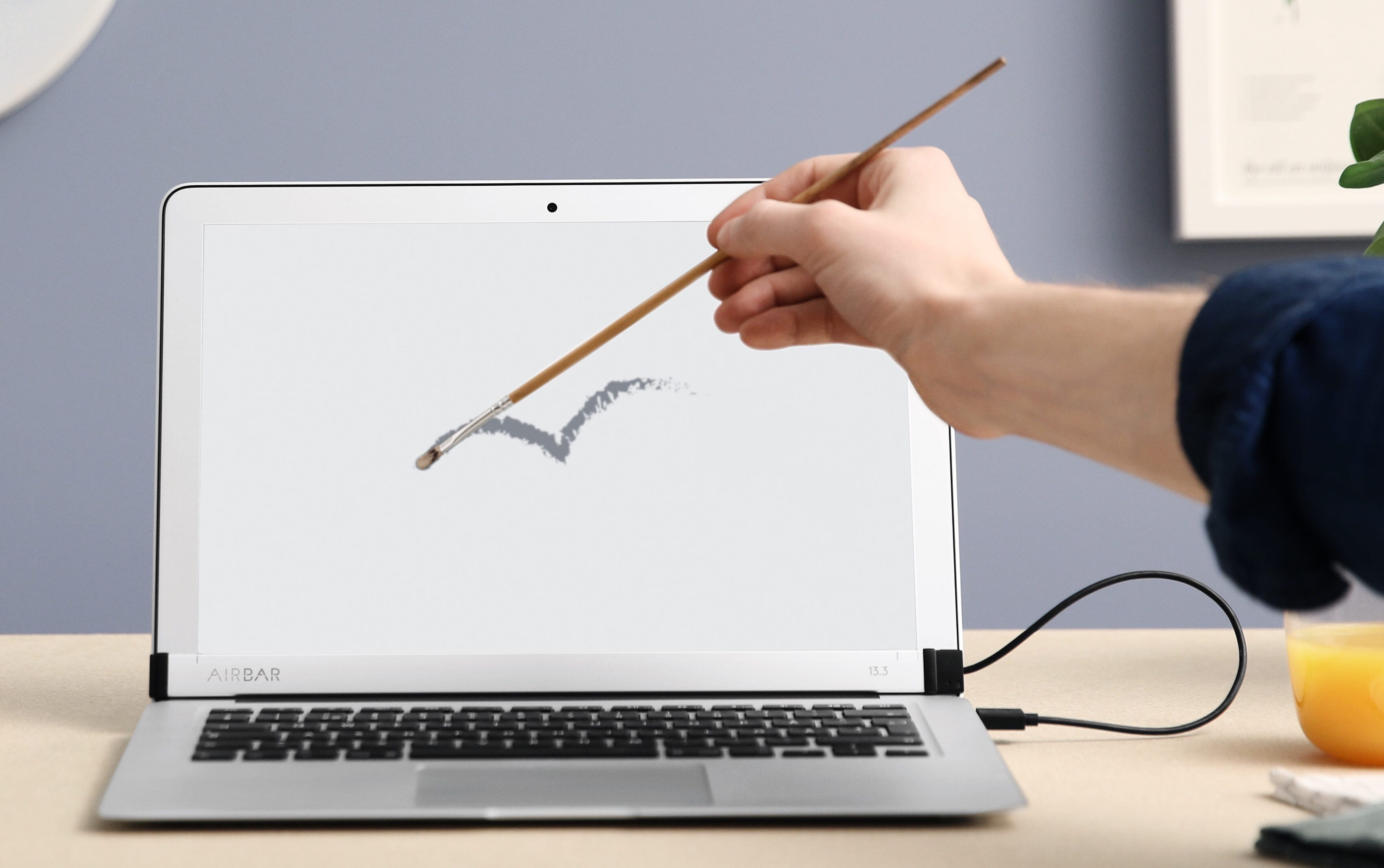 Airbar ajoute un cran tactile au macbook air 13 for Mac fenetre hors ecran